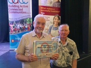 Peter and Ron accepting a cheque from Bendigo Bank & BACC