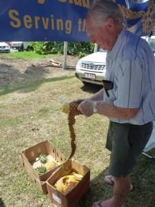 Ron peels pineapples
