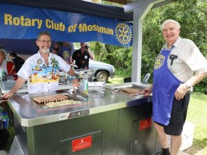 Terrey & Roby sizzling the sausages